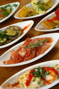 Gimme Gastronomy Tour. Spain (10 Days). A table full of Spanish tapas.