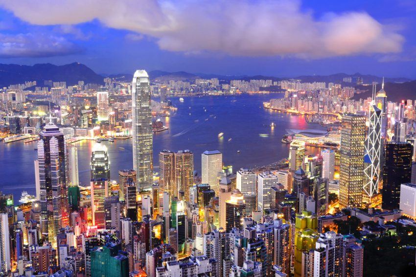 5 Best Destinations for Winter Sun. Hong Kong central district skyline and Victoria Harbour view at night