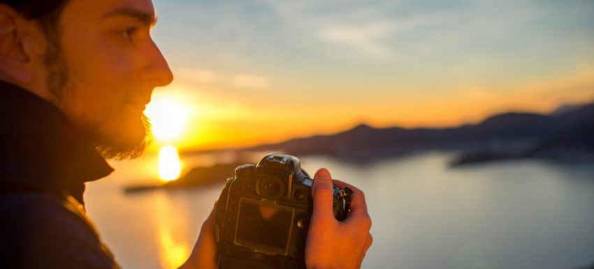 10 Tips For Making Best Photos in a Trip. Man photographing sunset on the top of mountain