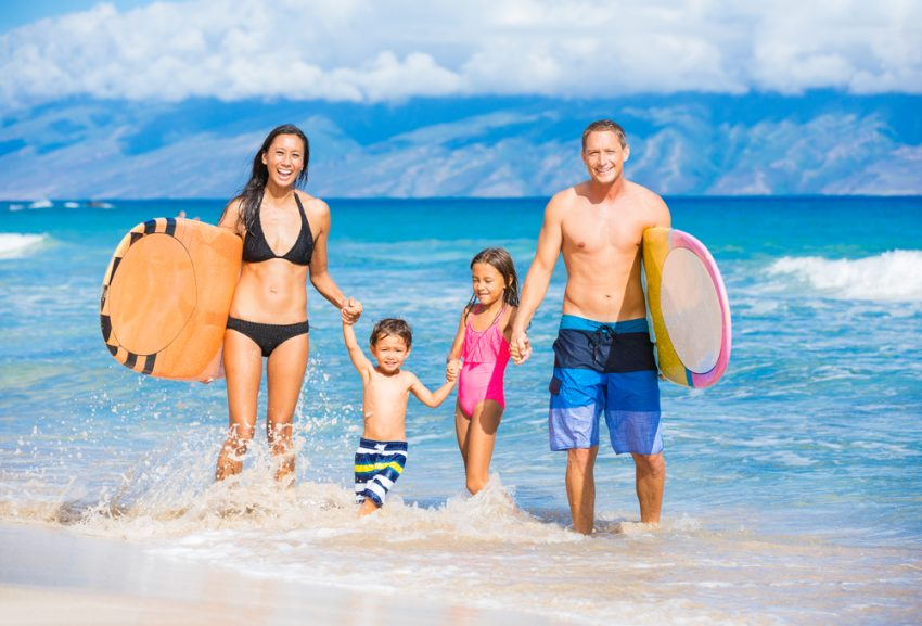 Where to Travel with Your Kids Before they Grow Up. Happy Family with Surfboards