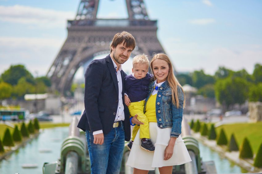 FAMILY TOUR OF FRANCE. Happy family in Paris