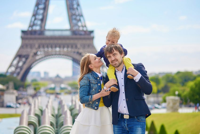 Where to Travel with Your Kids Before they Grow Up. Happy family of three in Paris
