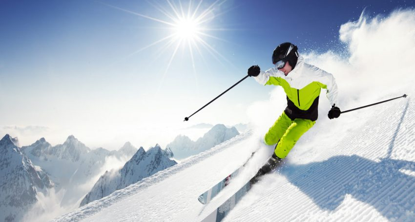 Why You Should Spend Money On Experiences Not Things. Skier in mountains, prepared piste and sunny day