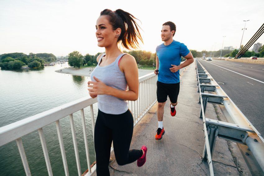 Stay in Shape While Traveling: 5 Easy Tricks. Athletic couple jogging together outdoors