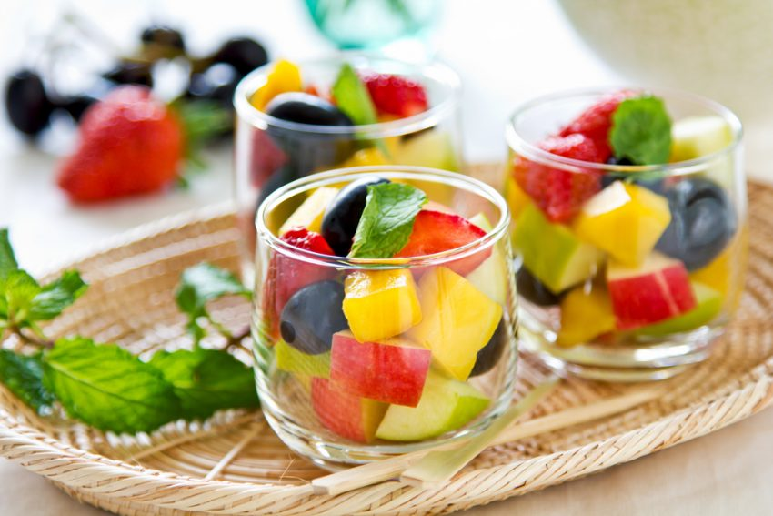 How To Stay Healthy While Traveling. Varieties of fruits as in small glass.