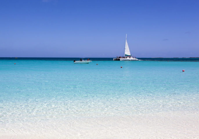 The Reef Atlantis: Dolphins and a Dining Credit. The view of colorful sea from Paradise Island beach (The Bahamas)