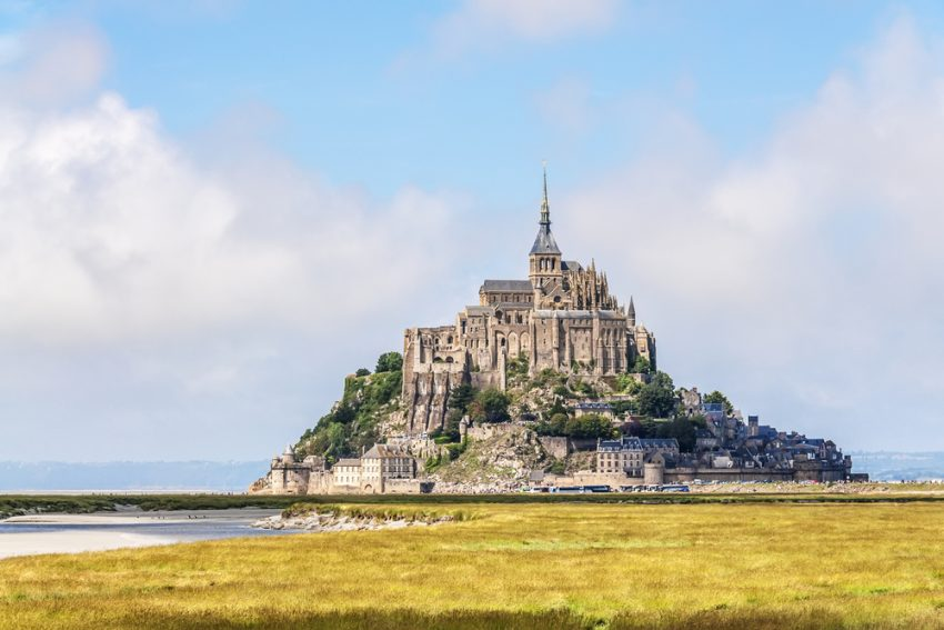 The Most Relaxing Tourist Gateways. View to Mount St Michel in Normandy, France.