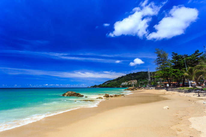 TOP REASONS TO VISIT SOUTHEAST ASIA. Gorgeous Kalim Beach at morning, Phuket, Thailand.