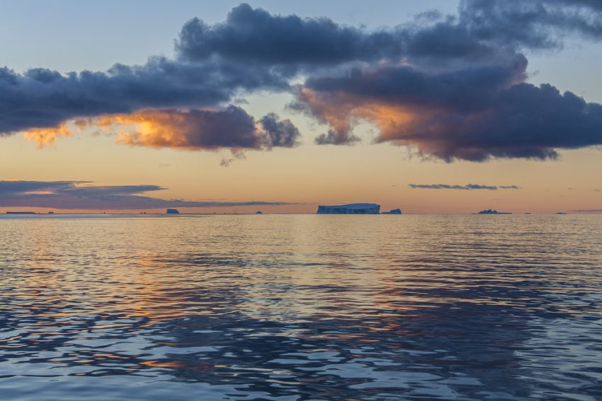 Antarctic Explorations. The Midnight sun over the icebergs of the Drake Passage near the Antarctic Peninsula in Antarctica. Photo: depositphotos.com