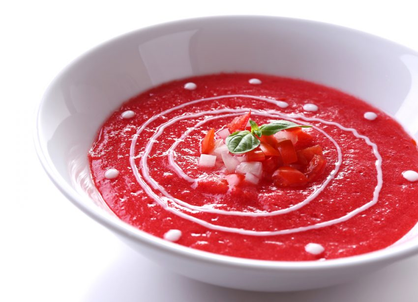 5 Must-Try Spanish Dishes. Gazpacho soup isolated on white.