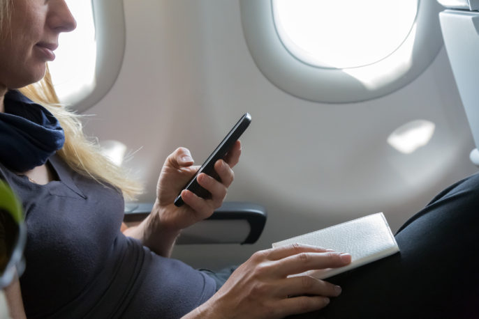 TIPS TO SURVIVE AND THRIVE ON LONG FLIGHTS