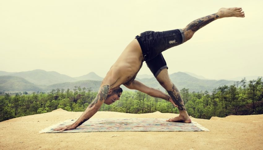 Fitness Tourism. Man Doing Yoga Exercise Concept