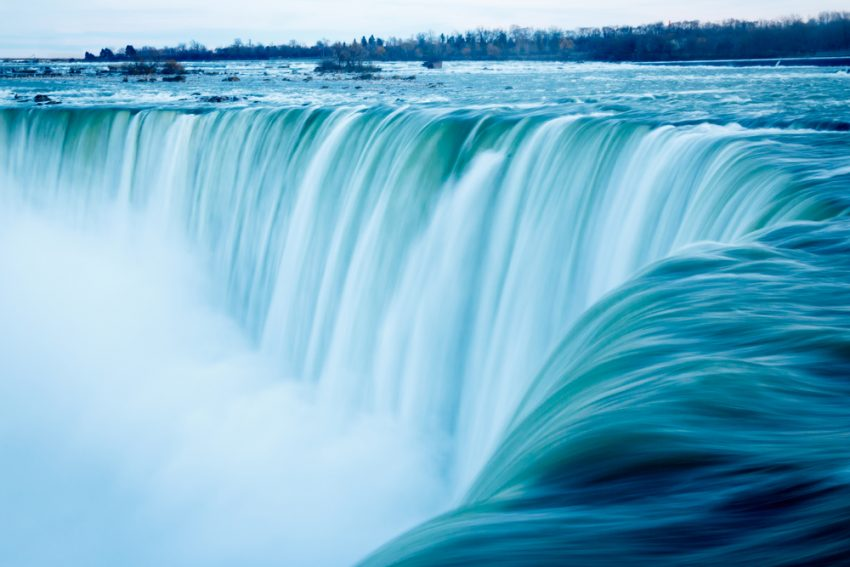 Five Things to Do in Niagara Falls. Water rushes over the edge of the Horseshoe Falls, Niagara Falls, Canada