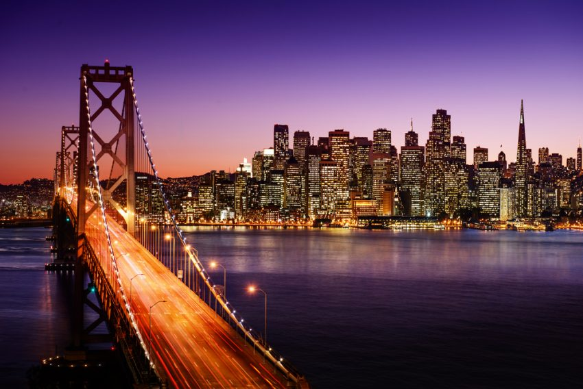 Most Popular US Tourist Cities. San Francisco skyline and Bay Bridge at sunset, California