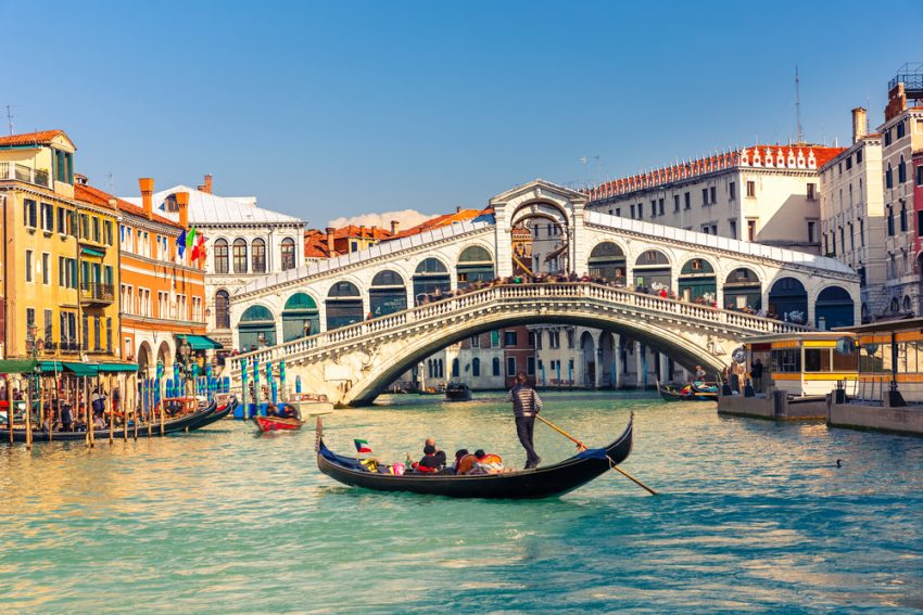 The Trendiest Autumn 2017 Destinations. Gondola near Rialto Bridge in Venice, Italy