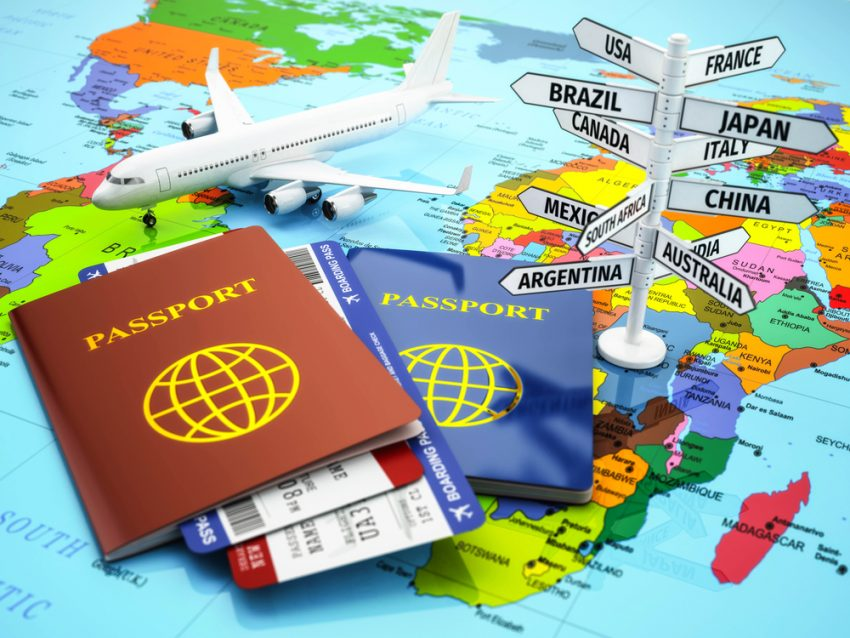 Reasons to Use A Travel Advisor in 2017. Travel or tourism concept. Passport, airplane, airtickets