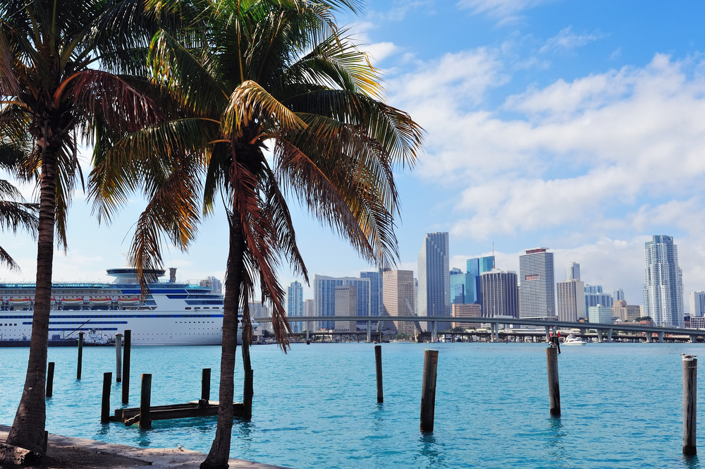 Caribbean Cruise Vacations. Miami city tropical view over sea from dock in the day with blue sky and cloud.