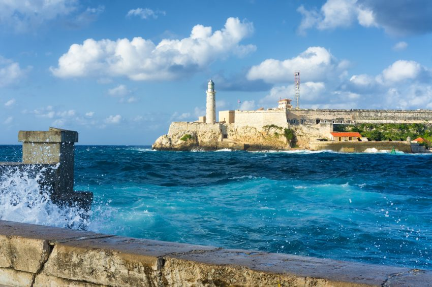 Air Transat Seat Sale. The famous castle of El Morro in Havana with a stormy weather and big waves in the ocean