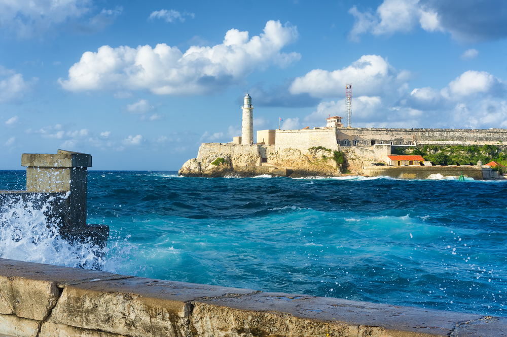 The famous castle of El Morro in Havana with a stormy weather and big waves in the ocean