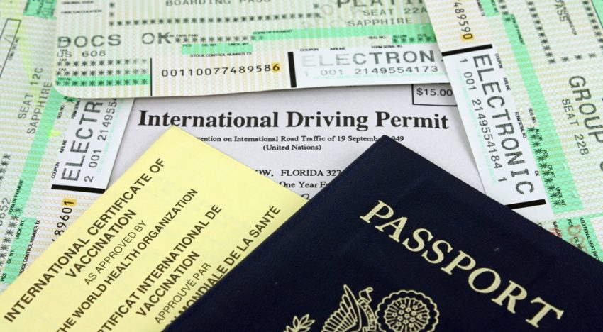 Essential Things You Should Always Pack. Collection of Travel Documents - Passport, International Driving Permit, International Vaccination Certificate and Airline Boarding Passes.
