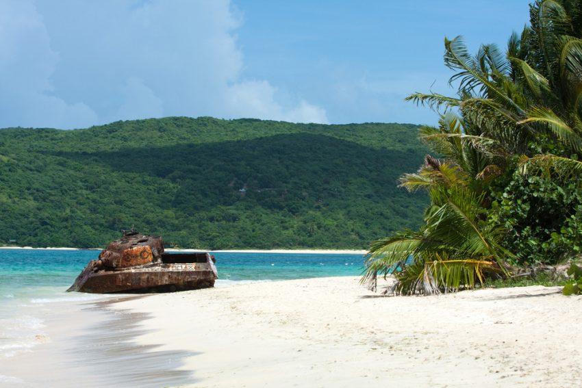 Cheap flights to Puerto Rico. The old rusted and deserted military tank of Flamenco beach on the Puerto Rican island of Culebra.