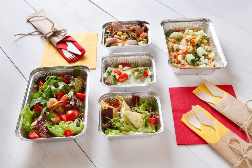 Favorite Ideas For Healthy Eating On The Road. Fitness food. Weight loss nutrition diet. Take away of healthy food. Eat right concept, diet, clean food take away in aluminium boxes, vegetable salads and meat at white wood. Healthy lunch