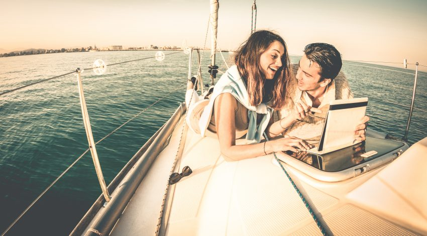 Why You Should Travel as a Couple Before Marriage. Young couple in love on sail boat