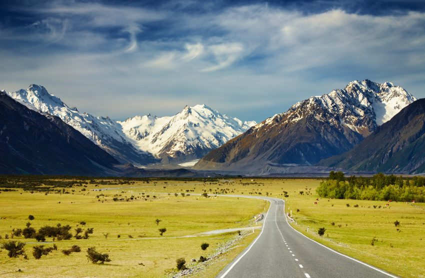 The Beauty of New Zealand: How to Explore this Land. Landscape with road and snowy mountains, Southern Alps, New Zealand