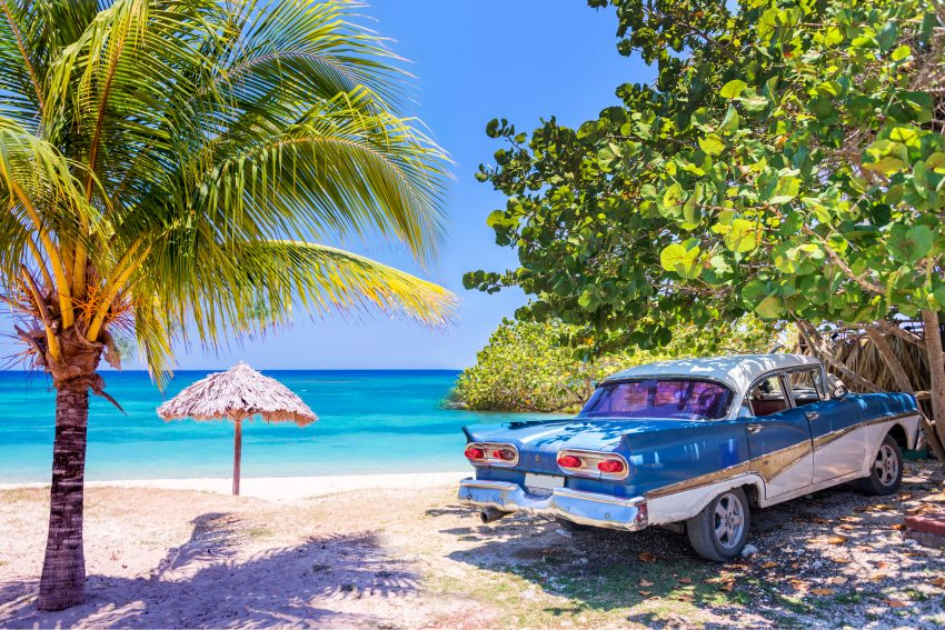 New Year in Havana: Vintage american old timer car parked on a beach in Cuba